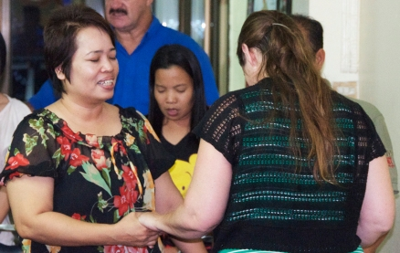 Praying with Pastor Nong Lak (Mrs. Lak) and her husband.