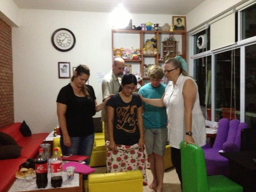 Praying over our host, Mae, who teaches at the university and runs a coffee shop where she ministers to local students.