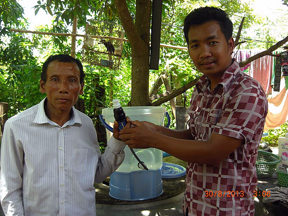 Our Cambodian friend Bona sets up one of 11 water filters sent to residents in his home village near Battambang, Cambodia.