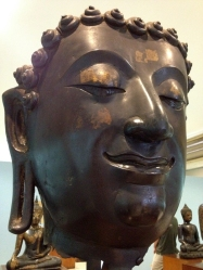 Buddha face in a historical museum, where we prayed.