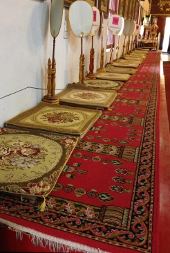 A line of mats inside the temple building.