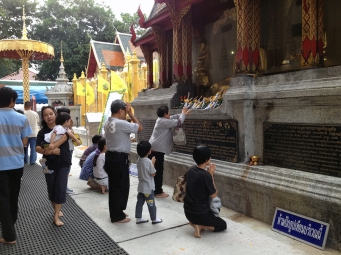 Making an offering at the temple.