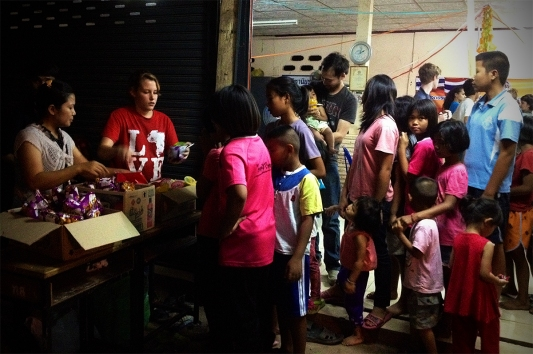 Jaynee helped pass out snacks to children in a slum village we visited one night. We showed one of Create's films specifically produced for the people of Issan.