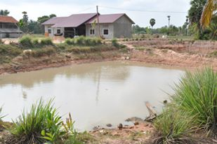 One of two water ponds at the village. The water in these ponds are used for everyday necessities, like cooking and bathing, washing dishes, watering livestock. Although bottled water is available for drinking, I have seen children drink this water while taking breaks at school. The planned water system will turn these ponds into water treatment ponds, which will provide cleaner water for villagers who also use the ponds and also for livestock in the area.